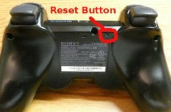 Back of PS3 controller showing reset button.